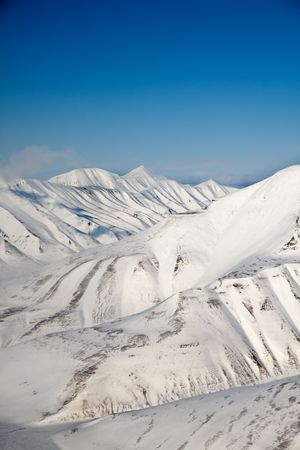 svalbard: A snow covered mountain range in Svalbard