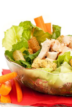 chicken caesar salad: A bowl of chicken Caesar salad isolated on white Stock Photo