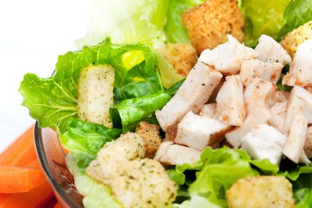 A chicken caesar salad detail photo