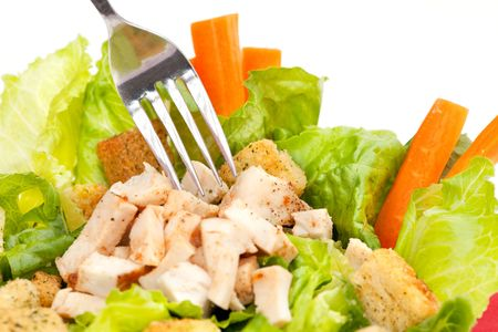 chicken caesar salad: Chicken Caesar Salad detail with carrots and croutons
