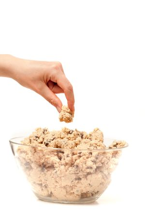 sneaking: A hand sneaking a taste test of cookie dough. Stock Photo