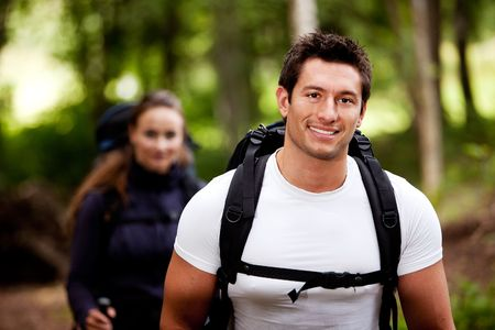great lakes: A portrait of a male hiking in the forest with a female