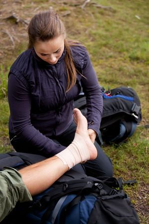 sprain: A leg tensor bandage being applied outdoors