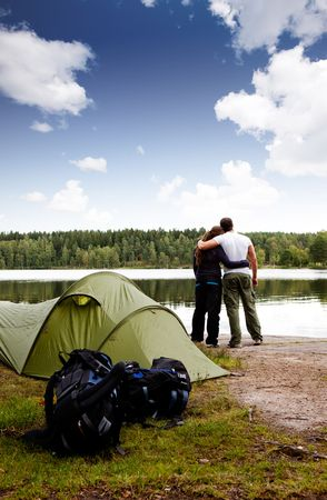 A summer camping lifestyle shot with a forest and lake landscape photo