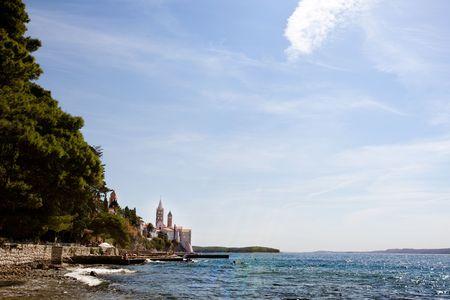 The coast of the old city of Rab, Croatia on the island of Rab photo