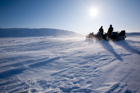 Travelling in a very cold winter landscape with blowing snow photo