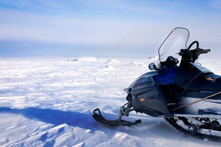 barren: A snowmobile on a barren winter landscape