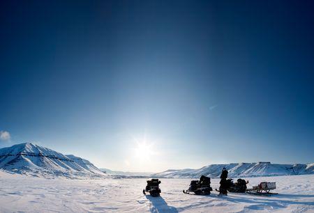 Three snowmobiles on a beautiful winter landscape photo
