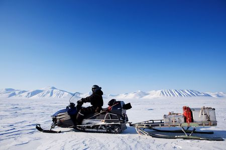 spitsbergen: A snowmobile on an arctic expedition on a frozen lake