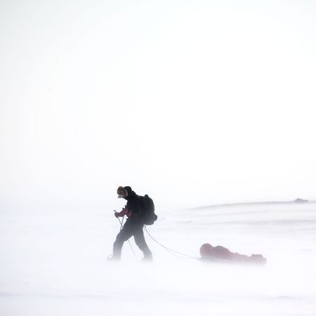 wind storm: An adventurer in a cold winter storm Stock Photo