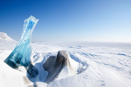 spitsbergen: A piece of glacial ice sticking out of the frozen ocean, Spitsbergen, Svalbard, Norway Stock Photo