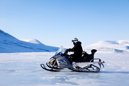 A snowmobile on a beautiful winter mountain landscape photo