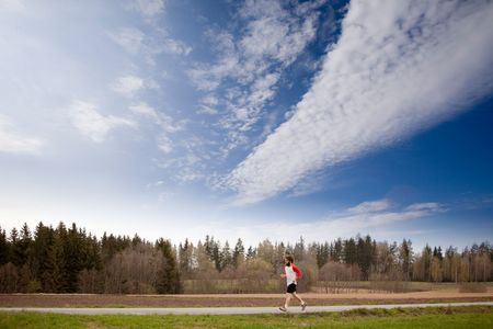 A runner with long hair and beard jogging in the country Stock Photo - 5693286