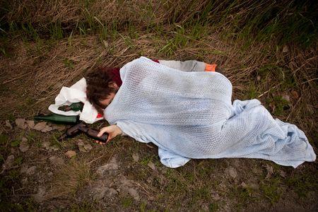 destitute: A drunk homeless man sleeping in a ditch Stock Photo