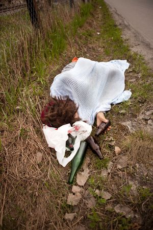 A homeless person sleeping in the ditch Stock Photo - 5693540