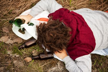 A homeless person sleeping in the ditch photo