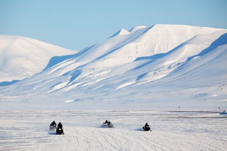 svalbard: A group of snowmobiles on the ice outside Longyearbyen, Svalbard Norway