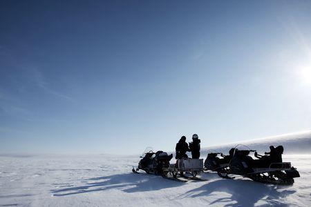A winter adventure guide on a barren winter landscape photo