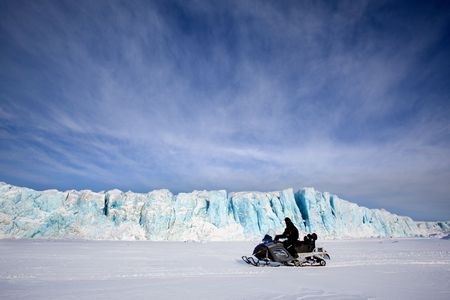 A glacier in Svalbard, Norway with travelling on the ice photo