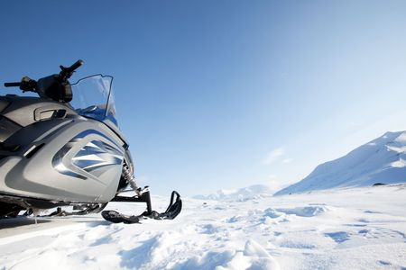 A snowmobile on a winter wilderness landscape photo