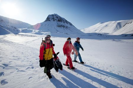svalbard: A group of tourists and a guide near Longyearbyen, Svalbard, Norway Stock Photo