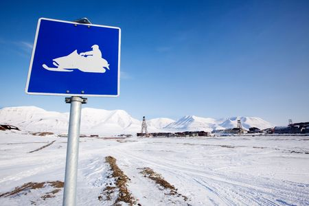 A snowmobile trail sign in Longyearbyen, Svalbard, Norway photo