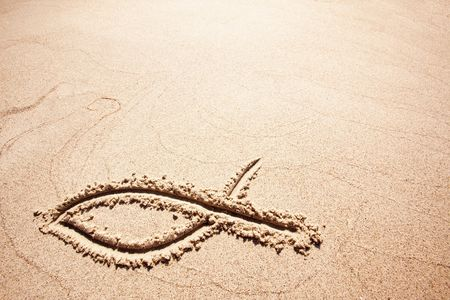 early: A fish symbol in drawn in the sand