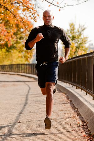 An African American jogging in a park in the morning photo