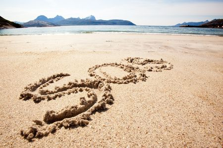 An S.O.S. message in the sand on an island Stock Photo - 5815499