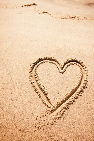 heart on the sand: A heart drawn in the sand on a beak Stock Photo