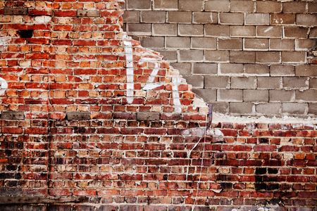 A brick and concrete wall with texture photo