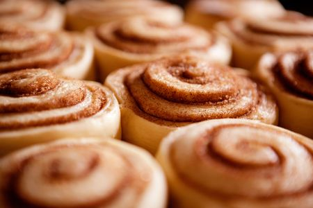 A detail of raw cinnamon buns - very shallow depth of field. photo