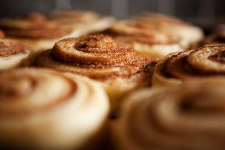 danish: A detail of raw cinnamon buns - very shallow depth of field.