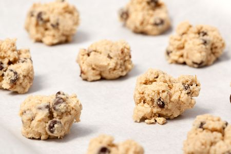 Raw cookie dough on a baking sheet with parchment photo