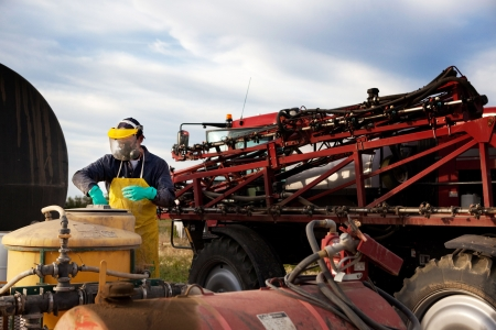 farm machinery: Filling a high clearance spraying with chemical and water