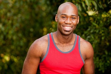 A portrait of an african american man taking a break from exercising photo