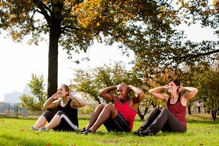 situp: A group of people doing exercises in the park