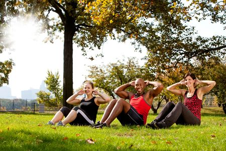 A group of people doing exercises in the park Stock Photo - 5857666