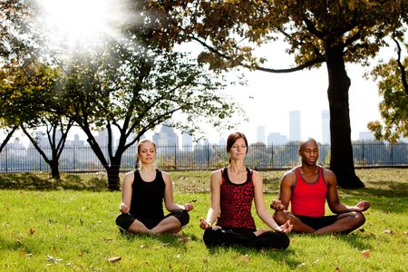 A group of people meditation in a city park photo