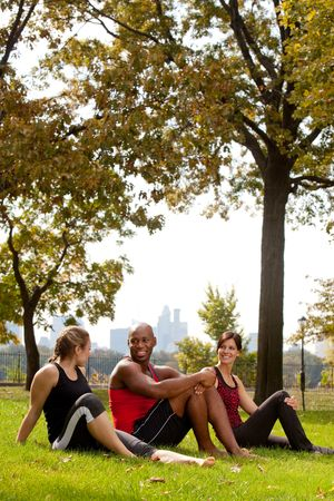 A group of people relaxing in the park after exercise photo