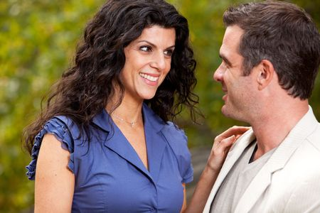 A woman looking happy at her husband / boyfriend - Focus on the woman Stock Photo - 5857670