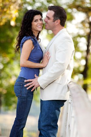A couple in the park with the man smiling at the woman Stock Photo - 5897929