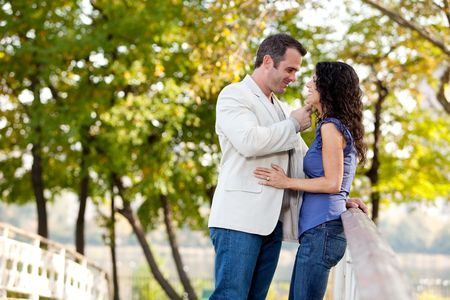 eachother: A couple looking at eachother and smiling Stock Photo