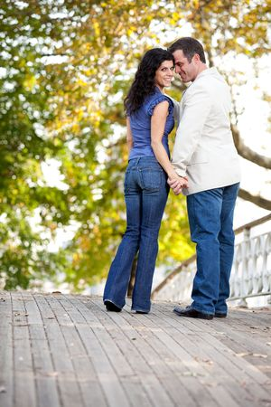 A happy couple in love walking on a bridge Stock Photo - 5898000