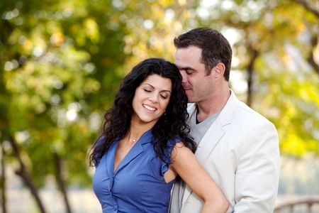 A man and woman showing affection in a park Stock Photo - 5897956