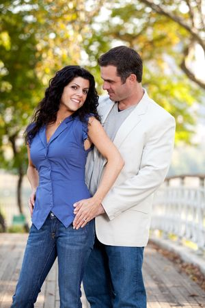 A portrait of a happy couple in the park Stock Photo - 5897987