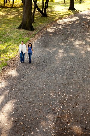 A happy couple walking in the park on a sunny day photo