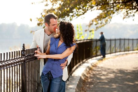 A happy couple kissing in the park on a beautiful day Stock Photo - 5897954