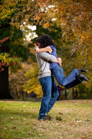 A man giving a woman a big hug - lifting her off the ground photo