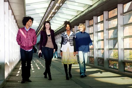 A group of friends walking in an urban setting Stock Photo - 5971812